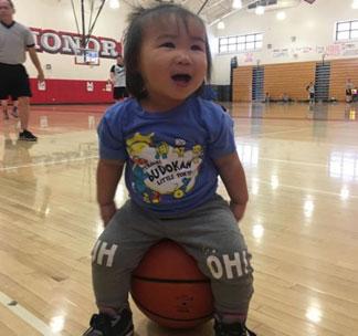 Little girl sitting on the ball